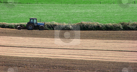 Tractor on the field stock photo, Tractor at work out on field, ploughing by Alexandru Cristian Ciobanu