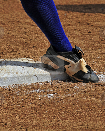 Ready on 1st base stock photo, Lower leg and foot standing on 1st base. by W. Paul Thomas
