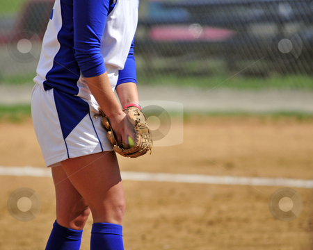 Ready to pitch stock photo, Mid body view of a woman softball pitcher preparing to pitch. by W. Paul Thomas