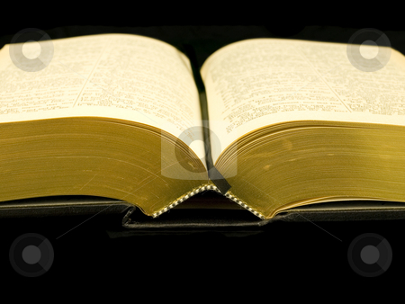 Open Book stock photo, Open Book on a black background by John Teeter