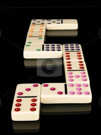 Dominos stock photo, Colored dominos on a black background by John Teeter
