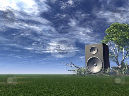 Vibrations stock photo, Big speaker on green field - 3d illustration by J?