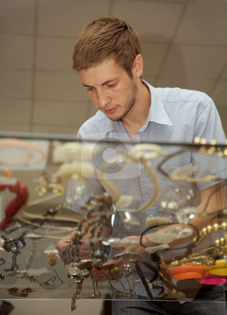 Customer stock photo, The buyer of shop chooses a gift for the favourite wife. by Sergey Goruppa