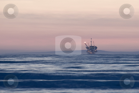 Off shore oil rig stock photo, And off shore oil drilling platform at sunset by Stephen Gibson
