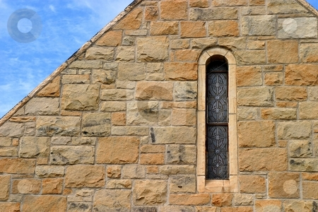 Small Church Windows stock photo, Small church window in stone wal with sky. by Henrik Lehnerer