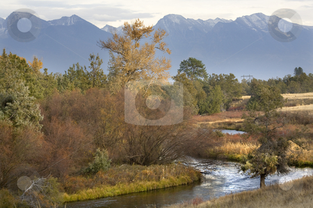 Fall Colors River Reflections Snow Mountains National Bison Rang stock photo, River Reflections Fall Colors Snow Mountains National Bison Range Charlo Montana by William Perry