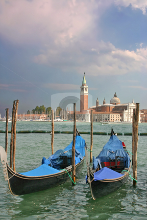 Gondolas moored by the Piazzetta di San Marco in Venice stock photo, Gondolas moored by the Piazzetta di San Marco in Venice with the Isola di San Giorgio Maggiore across the canal in the background and dramatic sky vertical by Stephen Goodwin