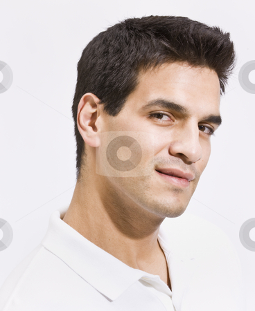 Headshot of Attractive Man with Chiseled Jaw stock photo, A headshot of a man.  He is smiling and has his face tilted toward the camera. Vertically framed photo. by Jonathan Ross