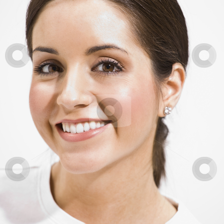 Headshot of Beautiful Brunette stock photo, The headshot of a beautiful brunette.  She is smiling directly at the camera.  Square framed shot. by Jonathan Ross