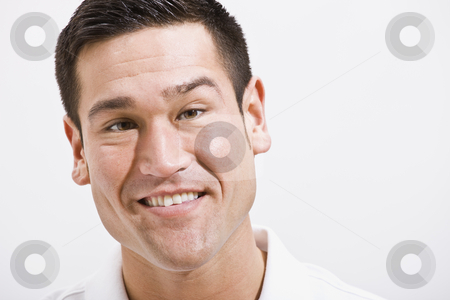 Close Up Portrait of Attractive male stock photo, Attractive male head shot, horizontally framed. He is smiling and looking at the camera. by Jonathan Ross