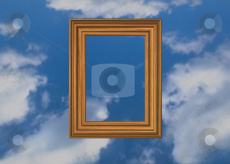 Heavenly picture stock photo, Wooden pictureframe and clouds by J?