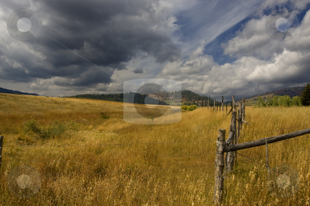 Storm stock photo, Farm with a storm comeing in with blue skys by Mark Smith