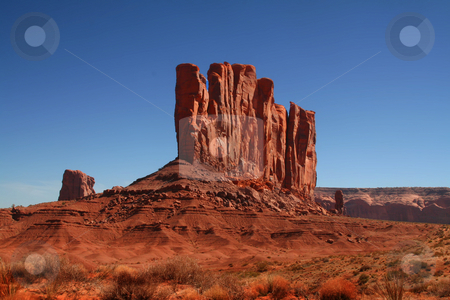 Monument Valley stock photo, View of the red rock formations in Monument Valley with blue sky by Mark Smith
