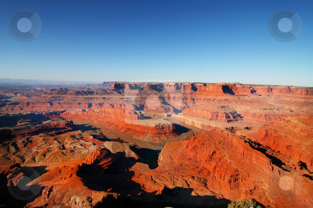 Red Rock Dead Horse Point stock photo, View of the red rock formations in Canyonlands National Park with blue sky by Mark Smith