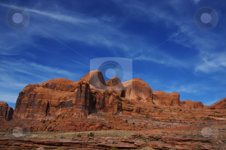 Canyonlands National Park stock photo, View of the red rock formations in Canyonlands National Park with blue sky???s and clouds by Mark Smith