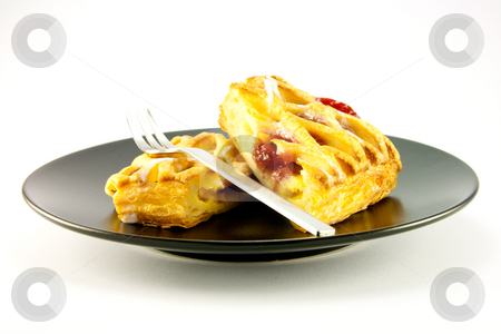 Raspberry Danish on a Black Plate stock photo, Raspberry and custard danish on a black plate with a fork on a white background by Keith Wilson