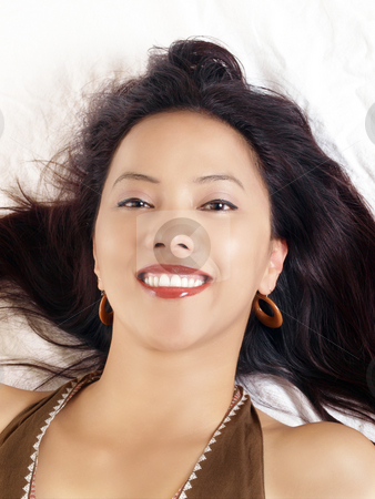 Young hispanic woman with big smile reclining  stock photo, Reclining portrait of young latina woman big smile by Jeff Cleveland