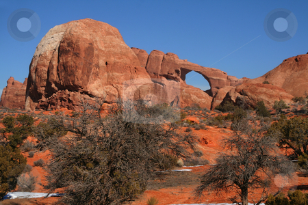 Arches National Park stock photo, View of the red rock formations in Arches National Park with blue sky by Mark Smith
