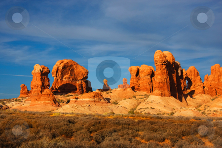 Desert Arches National Park stock photo, View of the red rock formations in Arches National Park with blue sky by Mark Smith