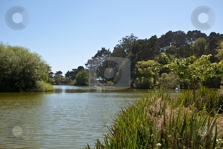 Stow Lake stock photo, Stow Lake surrounds the prominent Strawberry Hill, now an island with an electrically pumped waterfall. by Mariusz Jurgielewicz