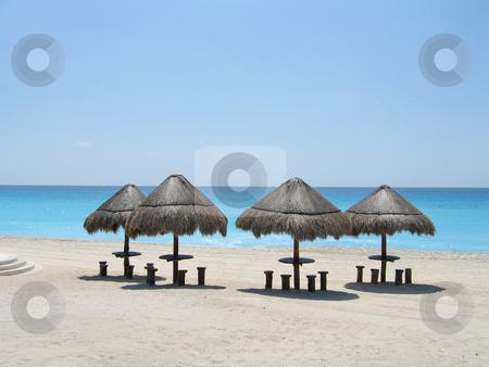 Palapas on beach stock photo, Palapas on stunning blue beach of Cancun by Shi Liu