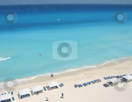 View of white sands and stunning blue sea stock photo, White tents and loungers on the beaches of cancun by Shi Liu