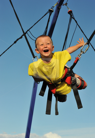 Bungee jumping stock photo, Little boy  jumping on the trampoline (bungee jumping). by Bonzami Emmanuelle
