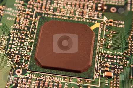 Computer Chip stock photo, A close up of a computer motherboard chip. by Brandon Seidel