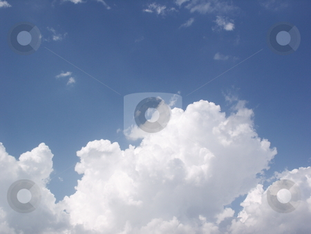 Cloud stock photo, Clouds on a sunny day against a dark blue sky. by Brandon Seidel
