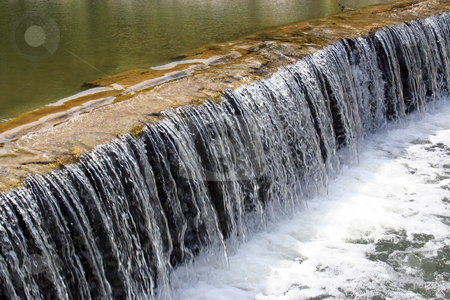 Acoustic Waterfall stock photo, An acoustic waterfall in a creek near a park in Round Rock, Texas. by Brandon Seidel