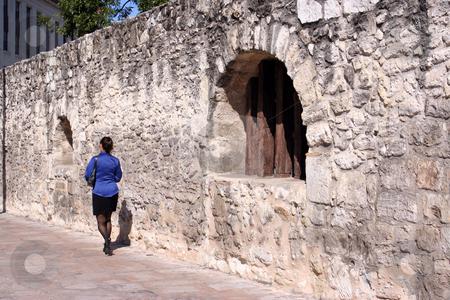 Business Woman Walking by the Alamo stock photo, Business woman walking by the Alamo by Brandon Seidel
