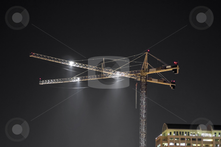 Crane At Night stock photo, A construction crane downtown at night. by Brandon Seidel