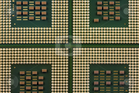 Computer Processors stock photo, Four green and gold computer processor chips by Brandon Seidel