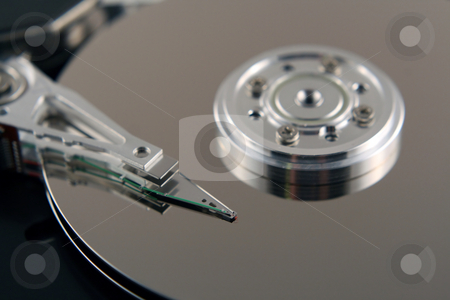 Computer Harddrive stock photo, The inside view of a computer harddrive by Brandon Seidel