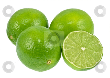 Green Limes stock photo, Green limes isolated on a white background. One lime is cut in half. by Brandon Seidel