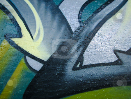 Glossy green graffiti on concrete stock photo, Glossy green graffiti on concrete wall by Annette Davis