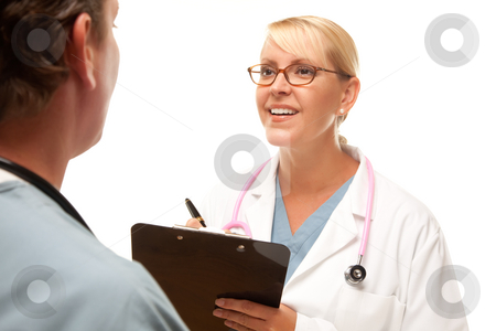 Male and Female Doctors Talking stock photo, Male and Female Doctors Talking Over File. by Andy Dean
