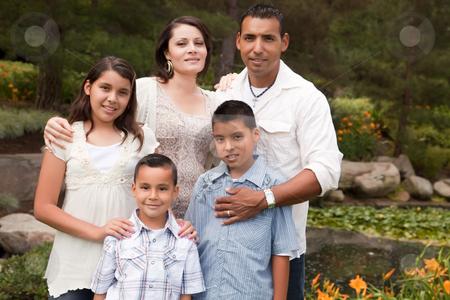 Happy Hispanic Family In the Park stock photo, Happy Hispanic Family Portrait In the Park. by Andy Dean