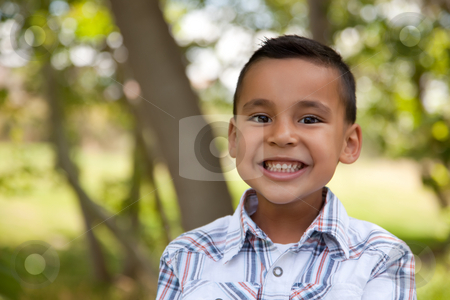 Handsome Young Boy in the Park stock photo, Handsome Young Hispanic Boy Having Fun in the Park. by Andy Dean