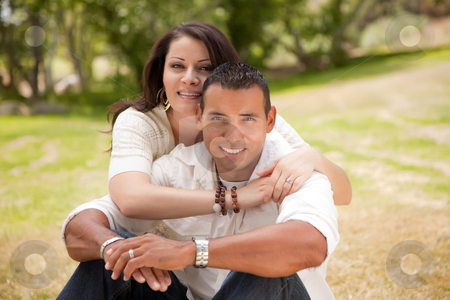 Happy Couple in the Park stock photo, Affectionate Happy Hispanic Couple in the Park. by Andy Dean