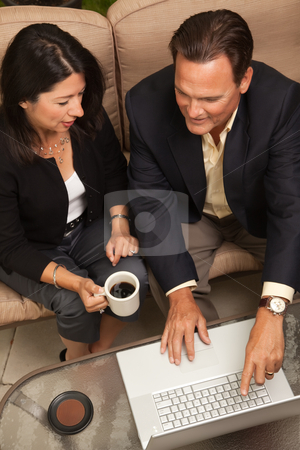 Man and Woman Using Laptop with Coffee stock photo, Man and Woman Using Laptop with Coffee by Andy Dean