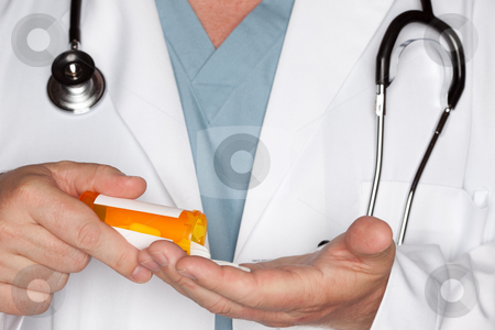 Male Doctor Abstract Pouring Out Pills stock photo, Male Doctor Abstract Pouring Out Pills from a Prescription Bottle by Andy Dean