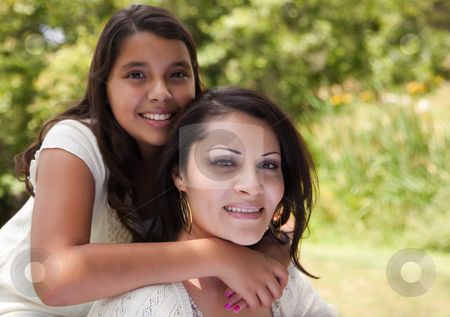 Mother and Daughter in the Park stock photo, Happy Hispanic Mother and Daughter in the Park. by Andy Dean