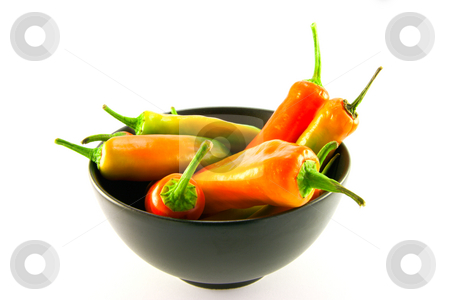 Chillis in a Black Bowl stock photo, Mixed red and green chillis in a black bowl with clipping path on a white background by Keith Wilson