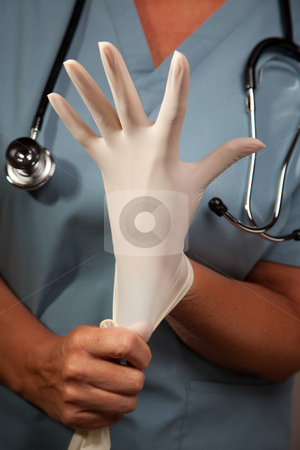 Abstract of Doctor Putting on Latex Gloves stock photo, Abstract Image of Doctor Putting on Latex Surgical Gloves. by Andy Dean