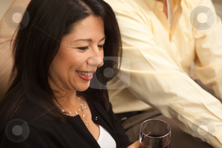 Attractive Hispanic Woman Enjoying Wine stock photo, Attractive Hispanic Woman Enjoying Wine with Friends. by Andy Dean