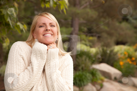 Attractive Blonde Woman in the Park stock photo, Attractive Blonde Woman Portrait in the Park. by Andy Dean