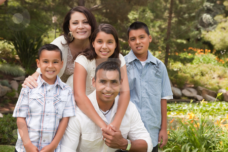 Happy Hispanic Family In the Park stock photo, Happy Hispanic Family Portrait In the Park. by Andy Dean
