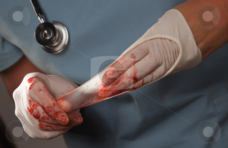 Abstract of Doctors Bloody Surgical Gloves stock photo, Abstract of Doctors Bloody Surgical Gloves, Scrubs and Stethoscope. by Andy Dean