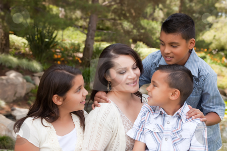 Happy Mother and Children in the Park stock photo, Happy Hispanic Mother and Children in the Park. by Andy Dean